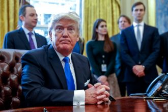President Donald Trump looks on after signing executive orders related to the oil pipeline industry in 2017. Credit: Shawn Thew-Pool/Getty Images