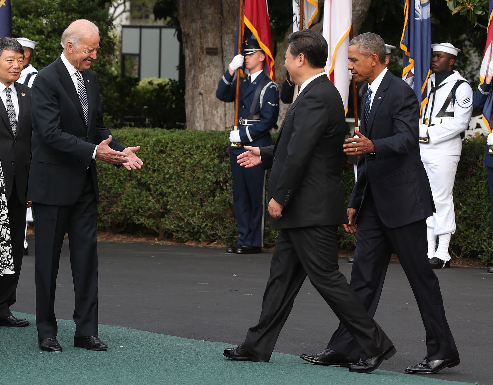 Vice President Joe Biden reaches to shake hands with Chinese president Xi Jinping, as President Barack Obama stands nearby during arrival ceremony at the White House September 25, 2015 in Washington, D.C. Credit: Mark Wilson/Getty Images