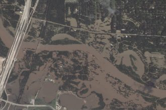 Floodwaters inundate the San Jacinto River basin in Houston, Texas, following Hurricane Harvey. Credit: DigitalGlobe via Getty Images