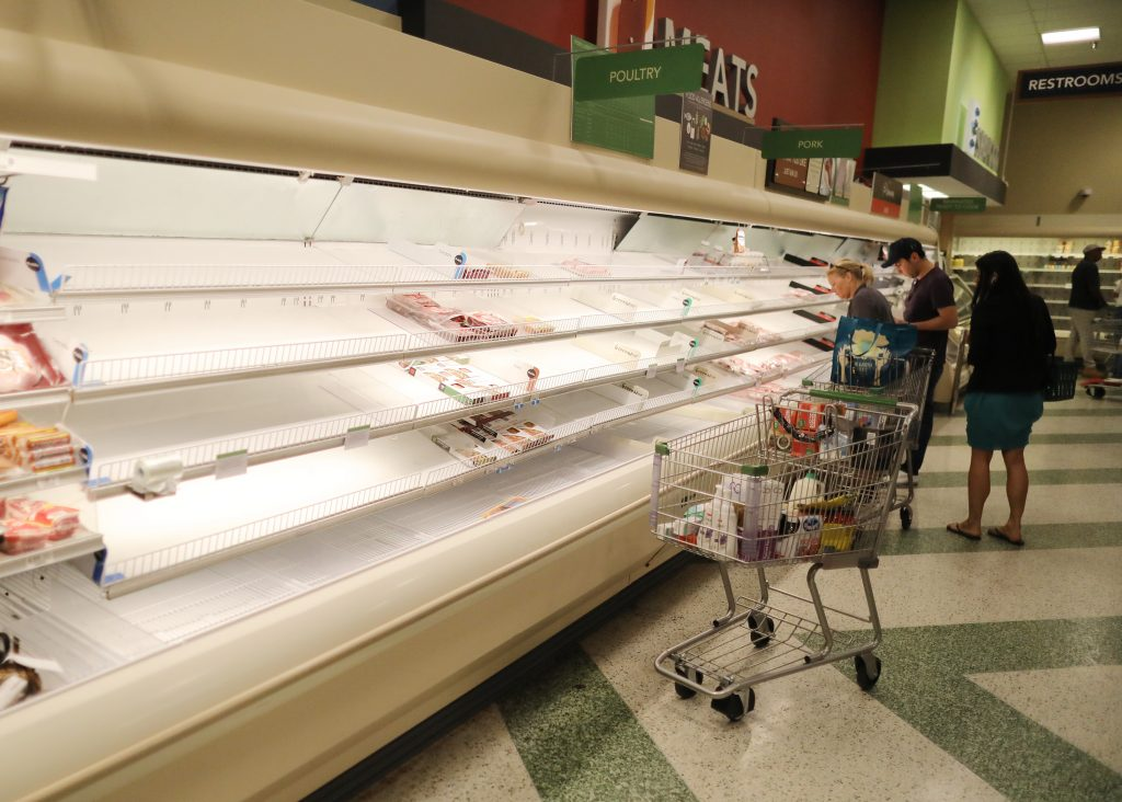 The coronavirus crisis left the meat section in a Miami Beach grocery store nearly empty on March 17, 2020. Credit: Joe Raedle/Getty Images