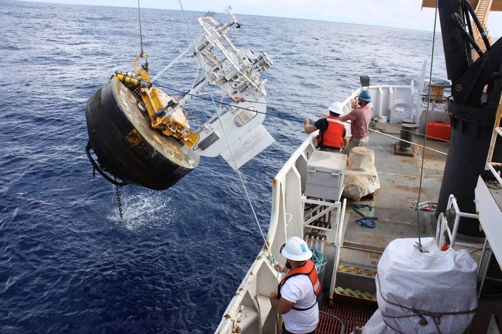 Scientists help service the Woods Hole Oceanographic Institution Hawaii Ocean Time Series Site (WHOTS) mooring.  Credit: NOAA
