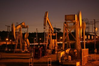 Oil companies have lost billions since the coronavirus pandemic began, according to new earnings reports. Credit: David McNew/Getty Images