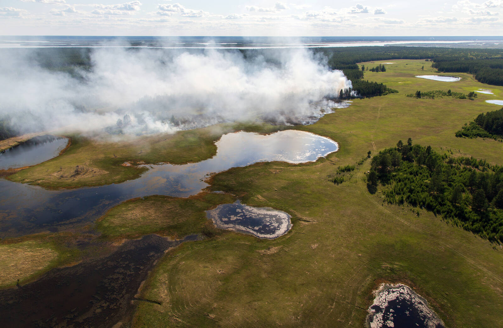 A view of a forest fire in central Yakutia from a helicopter. Credit: Yevgeny SofroneyevTASS via Getty Images