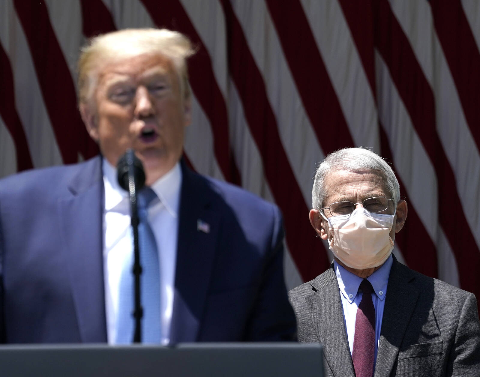 President Donald Trump is flanked by Dr. Anthony Fauci, director of the National Institute of Allergy and Infectious Diseases while speaking about coronavirus vaccine development on May 15, 2020 in Washington, D.C. Credit: Drew Angerer/Getty Images
