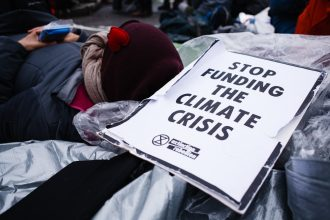 Extinction Rebellion activists protest on the Bank junction outside the Bank of America