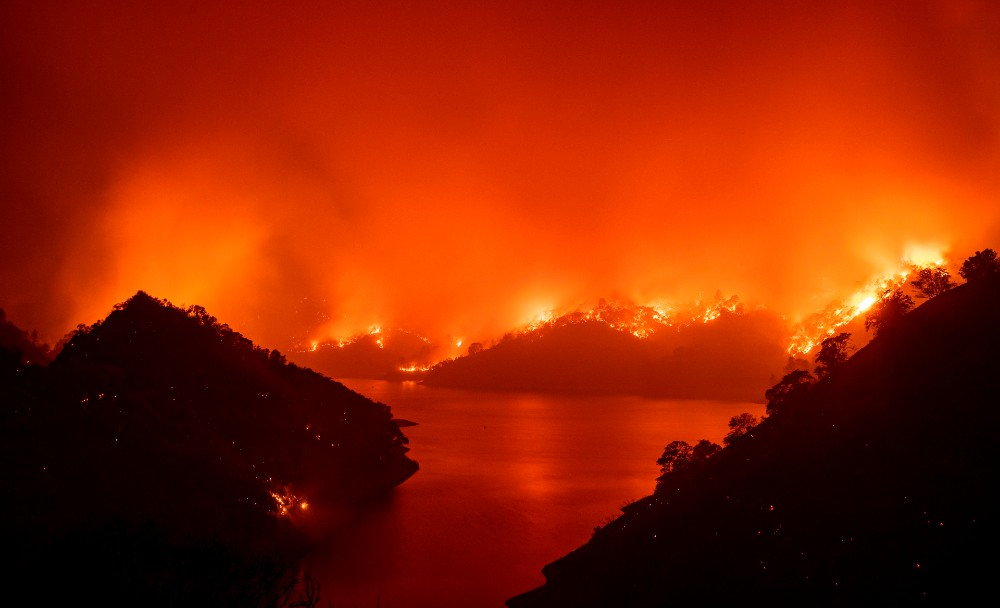 Flames surround Lake Berryessa during the LNU Lightning Complex fire in Napa, California on August 19, 2020.