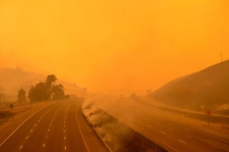 A firetruck drives along a closed Interstate 80 as flames from the LNU Lightning Complex fire continue to spread in California on August 19, 2020.