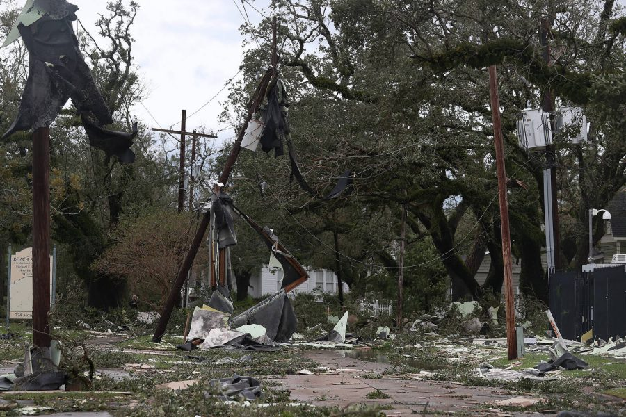 A street is seen strewn with debris and downed power lines after Hurricane Laura passed through the area on August 27, 2020 in Lake Charles, Louisiana . The hurricane hit with powerful winds causing extensive damage to the city.