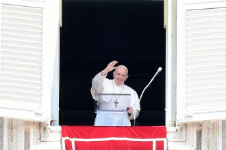Pope Francis delivers his blessing from the window overlooking St. Peter's Square at the Vatican during the Sunday Angelus prayer earlier this month. Credit: Filippo Monteforte/AFP/Getty