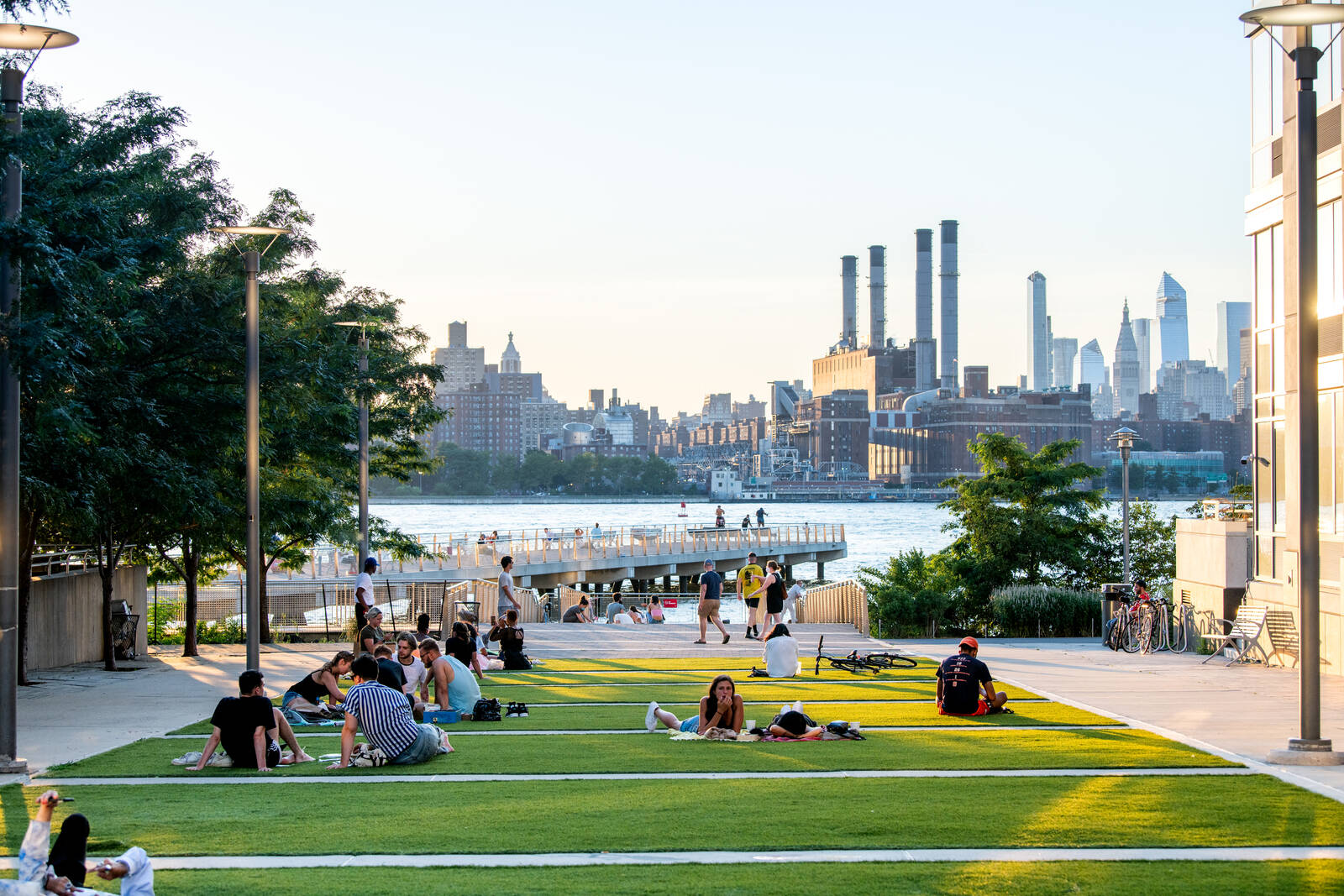 New Yorkers enjoy the outdoors near the pier in Williamsburg, Brooklyn on July 20, 2020 in New York, New York. Credit: Roy Rochlin/Getty Images