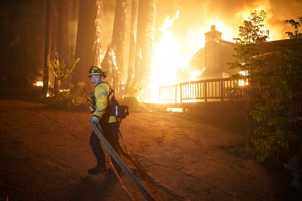 Firefighters work to protect homes surrounding residences engulfed in flames in Boulder Creek, California, on Saturday, August 22, 2020. Credit: Dylan Bouscher/MediaNews Group/The Mercury News via Getty Images