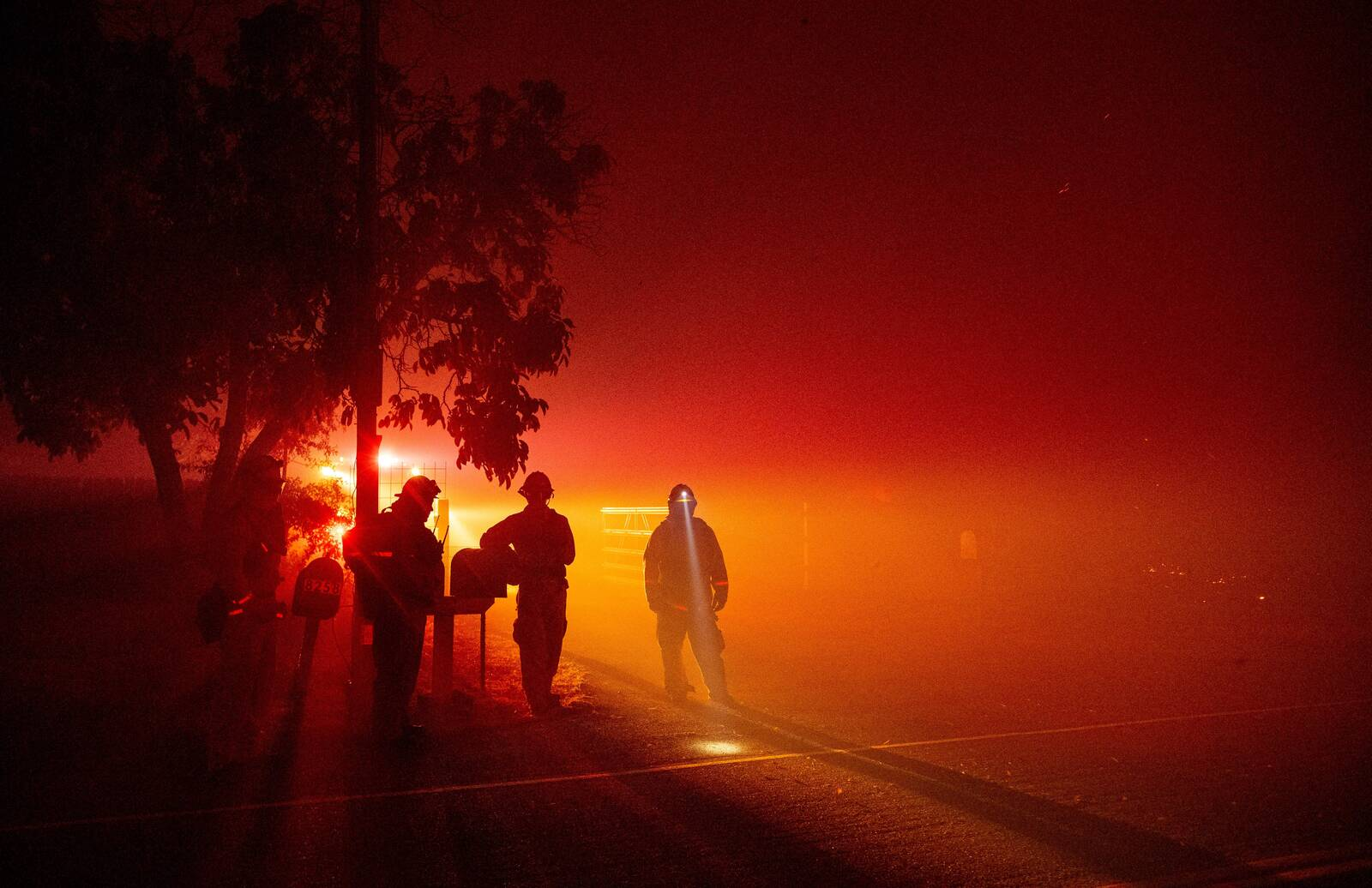 Firefighters monitor flames as they approach a residence in the valley area of Vacaville, northern California during the LNU Lightning Complex fire on August 19, 2020. Credit: Josh Edelson/AFP via Getty Images