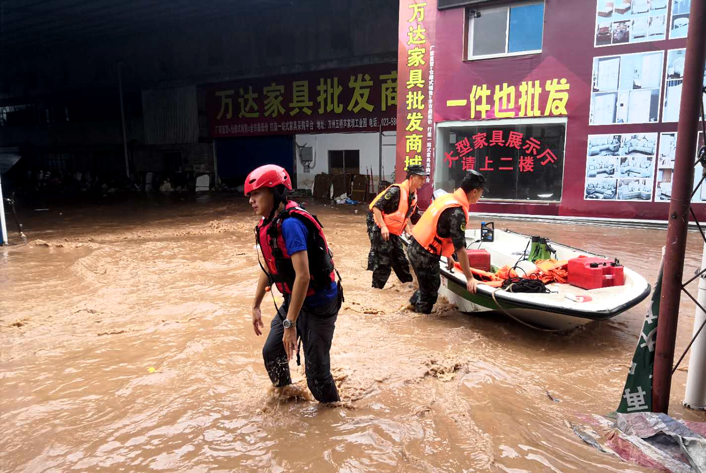 Paramilitary policemen evacuate people in a flooded region in Wanzhou in southwest China's Chongqing Municipality Thursday, July 16, 2020. Credit: Feature China/Barcroft Media via Getty Images