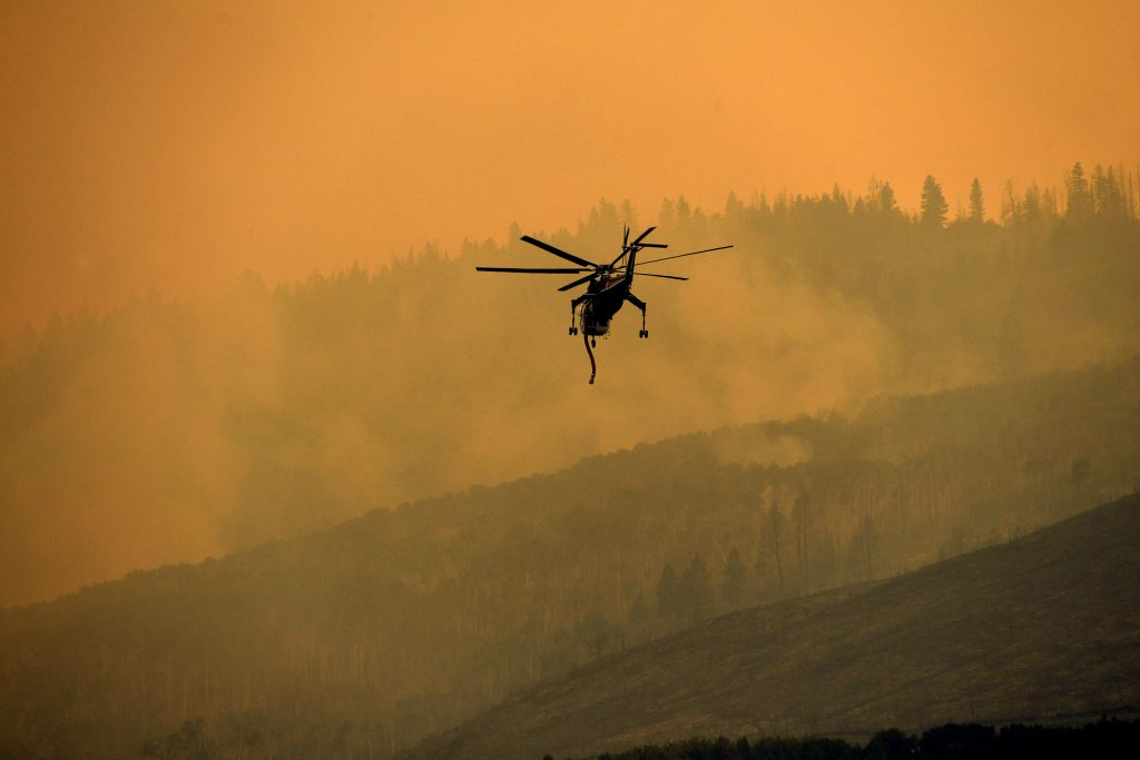 A Sikorsky Skycrane heads out to put water on the Grizzly Creek Fire fills on the east end of Glenwood Canyon on August 17, 2020 near Glenwood Springs, Colorado. Credit: Helen H. Richardson/MediaNews Group/The Denver Post via Getty Images