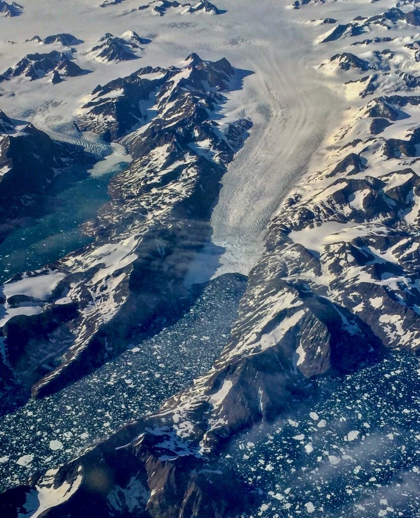 As Greenland's glaciers retreat from the sea, their floating tongues get thinner, break apart and lose their frozen grip on the seafloor. That speeds up the loss of ice from the thick interior ice sheet. Credit: Bob Berwyn