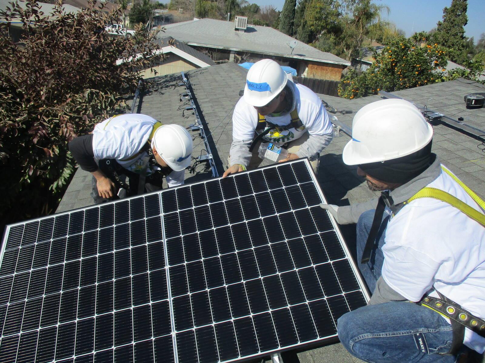 Volunteers for the nonprofit Grid Alternatives install solar panels on a house in Farmersville, California. Credit: Grid Alternatives