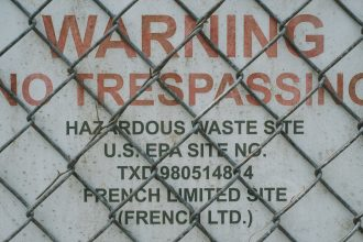 Warning signs are posted at the French Limited Superfund site. Credit: Spike Johnson