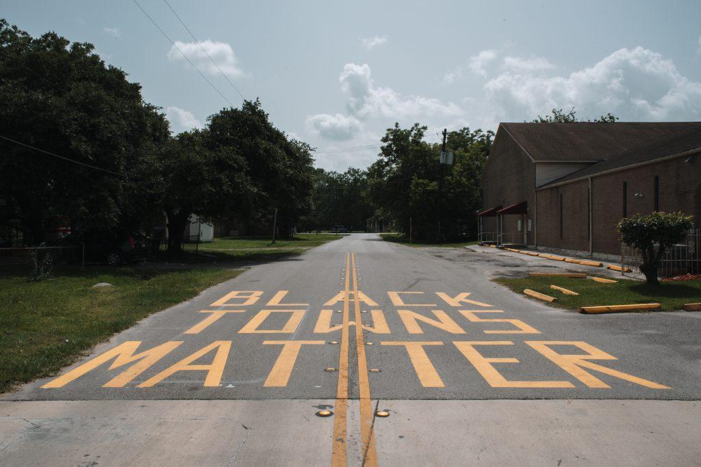 """Black towns matter"" painted on the street in Barrett, near Fred Barrett's home. Credit: Spike Johnson"