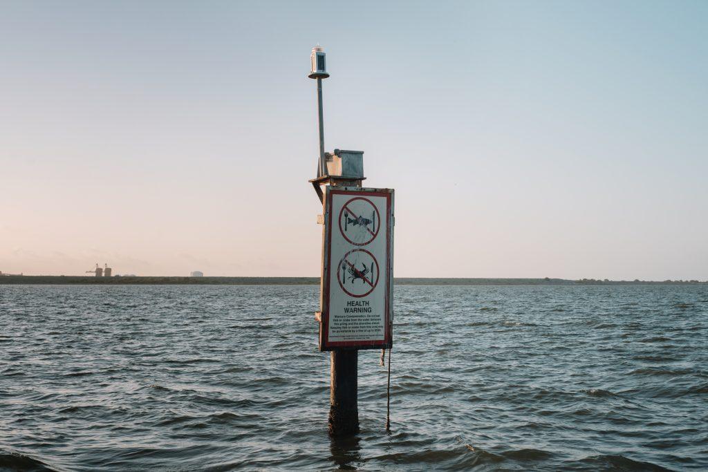 Warning signs surround Lavaca Bay's Superfund site. Credit: Spike Johnson