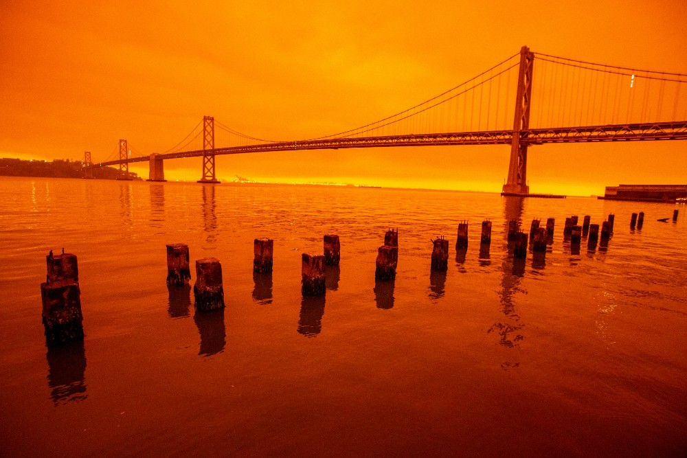 Smoky skies from the northern California wildfires turn the sky a glowing orange in San Francisco, California on Wednesday, Sept. 9, 2020. Credit: Ray Chavez/MediaNews Group/The Mercury News via Getty Images