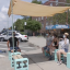 A group of volunteer designers and staff from community organizations built benches with shades in the Red Hook neighborhood of Brooklyn, New York to provide cool places for people to rest during heat waves. Credit: Anna Belle Peevey/InsideClimate News