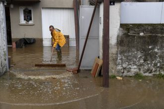 A man wipes water away following floods in Anduze, France on Sept. 19, 2020
