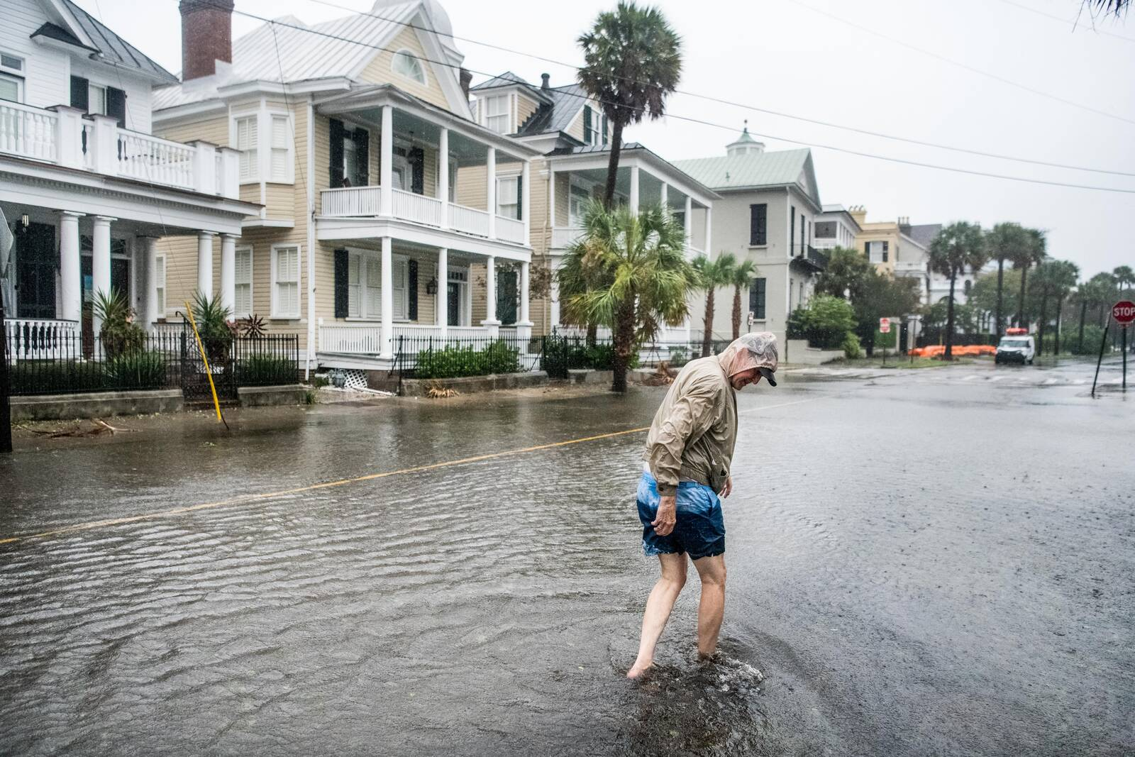 Bill Olesner walks down South Battery St. while cleaning debris from storm drains on Sept. 5, 2019 in Charleston, South Carolina. Credit: Sean Rayford/Getty Images