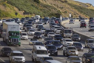 Afternoon commuter traffic streams northward from Los Angeles on the State Route 14 freeway on May 13, 2020 in Newhall, California. Credit: David McNew/Getty Images