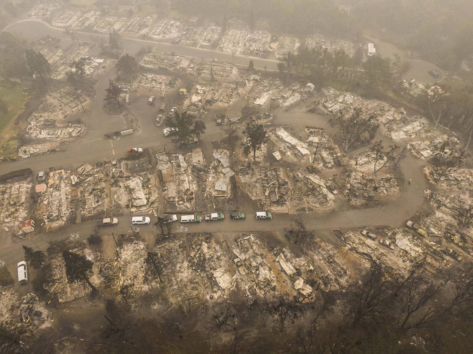 In this aerial view from a drone, search and rescue vehicles from the Jackson County Sheriff's Office are seen in a mobile home park that was destroyed by wildfire on Sept. 11, 2020 in Ashland, Oregon. Credit: David Ryder/Getty Images