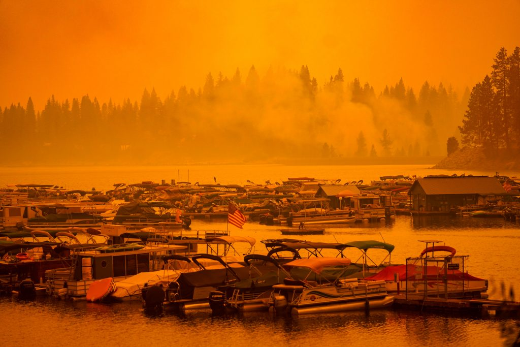 Boats at the Shaver Lake marina sit docked as smoke hangs in the air during the Creek Fire on Monday, Sept. 7, 2020 in Shaver Lake, California. Credit: Kent Nishimura/Los Angeles Times via Getty Images
