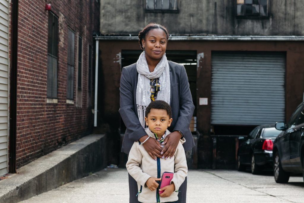 Melissa Miles with her son Kiluan in front of the plastics factory in Newark's Ironbound neighborhood. Credit: Brian Fraser/NBC News