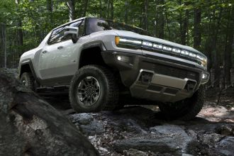 The 2022 GMC Hummer EV is scheduled to go on sale in late 2021, with a price tag of $112,595 and a battery range of 350 miles. Credit: GM
