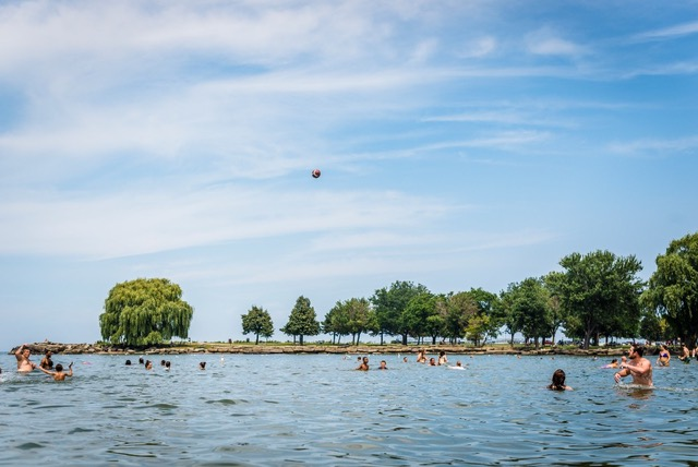 Cleveland residents enjoy a sunny afternoon in Lake Erie on July 29, 2015 in Cleveland, Ohio. Credit: Angelo Merendino/Corbis via Getty Images