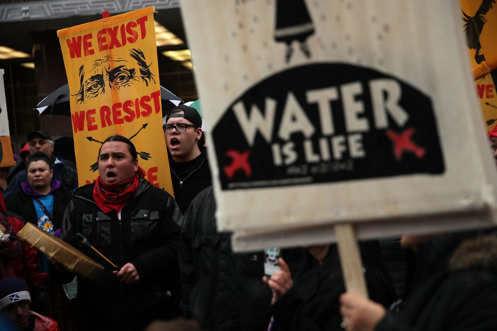 Activists gather outside the Army Corps of Engineers Office to protest against the Dakota Access Pipeline March 10, 2017 in Washington, DC. Credit: Alex Wong/Getty Images