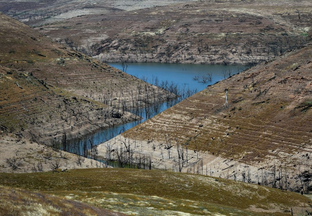 Water is seen at the bottom of the New Melones Lake reservoir as a severe drought affected California in May 2015. Credit: Mark Ralston/AFP via Getty Images