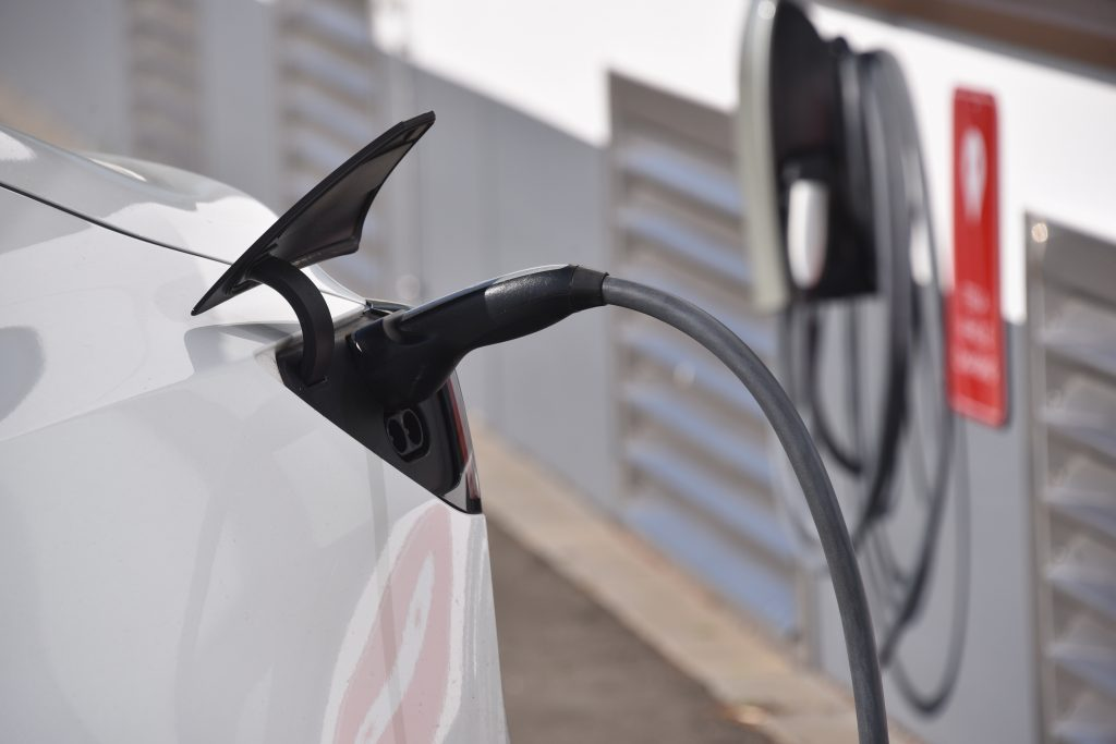 A Tesla Model 3 is charged at a charging station. Credit: Horst Galuschka/picture alliance via Getty Images