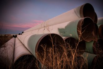 Miles of unused pipe, prepared for the proposed Keystone XL pipeline, sit in a lot on Oct. 14, 2014 outside Gascoyne, North Dakota. Credit: Andrew Burton/Getty Images