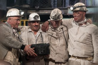 Holger Kenda, on the far right, on his last day working in the mines, Dec. 21, 2018. It was a media event, with the ceremonial extraction of the last piece of hard coal from an underground mine in Germany. The end of subsidies for mining hard coal meant t