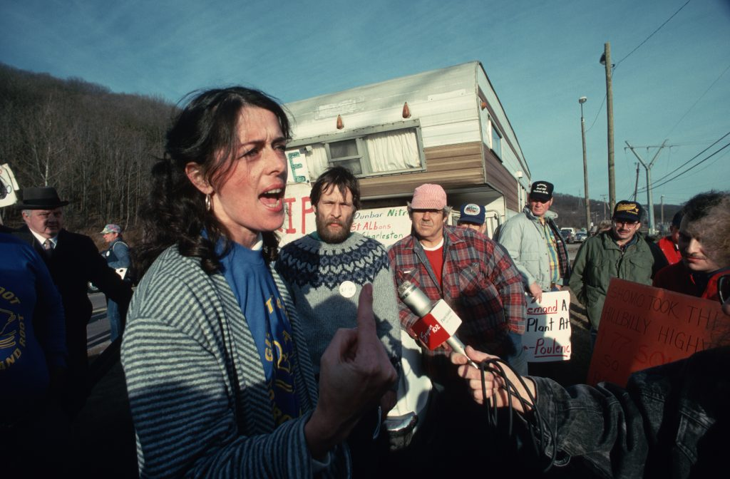 Lois Gibbs speaks to an interviewer at a 1970 rally. A long-time Superfund activist, Gibbs was initially impressed with the way the Trump EPA set out to prioritize Superfund site cleanups but later became critical that those sites were not the ones facing
