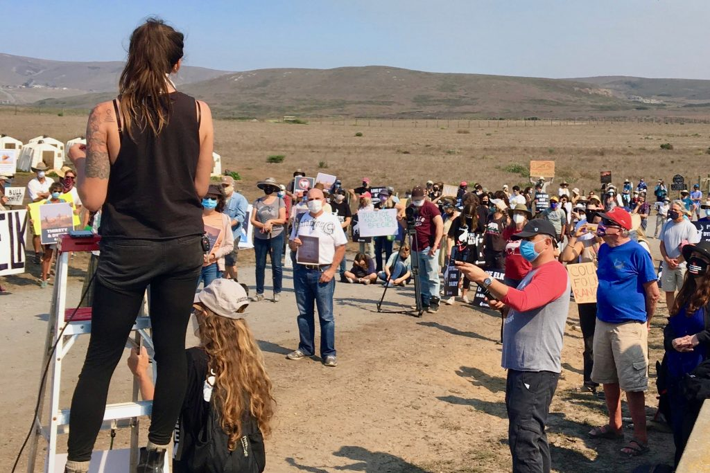 Diana Oppenheim (left) leads demonstrators in Point Reyes National Seashore. The group of nearly 300 protested the National Park Service's plan to cull animals in the Drakes Beach tule elk herd. Courtesy of Diana Oppenheim