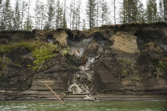 Melting permafrost cliffs near Zyryanka, Russia are crumbling into the Kolyma River, unleashing tons of organic soil sediments that can release CO2 and methane to the atmosphere. Analyzing those sediments from deposits on the ocean floor helps show how fa