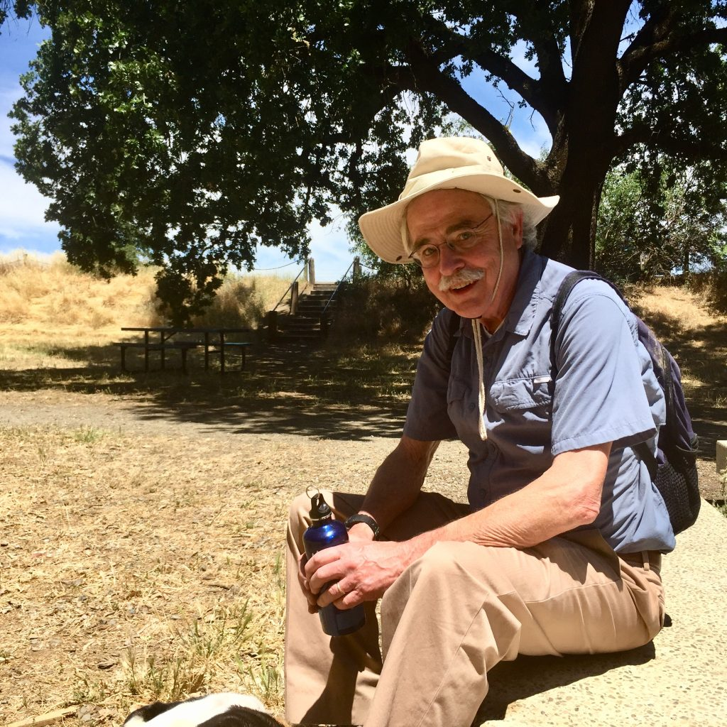 Peter Moyle, the leading expert on California's fish, sits on a bench by Putah Creek, a stream his work helped revive. Credit: Evelyn Nieves/InsideClimate News