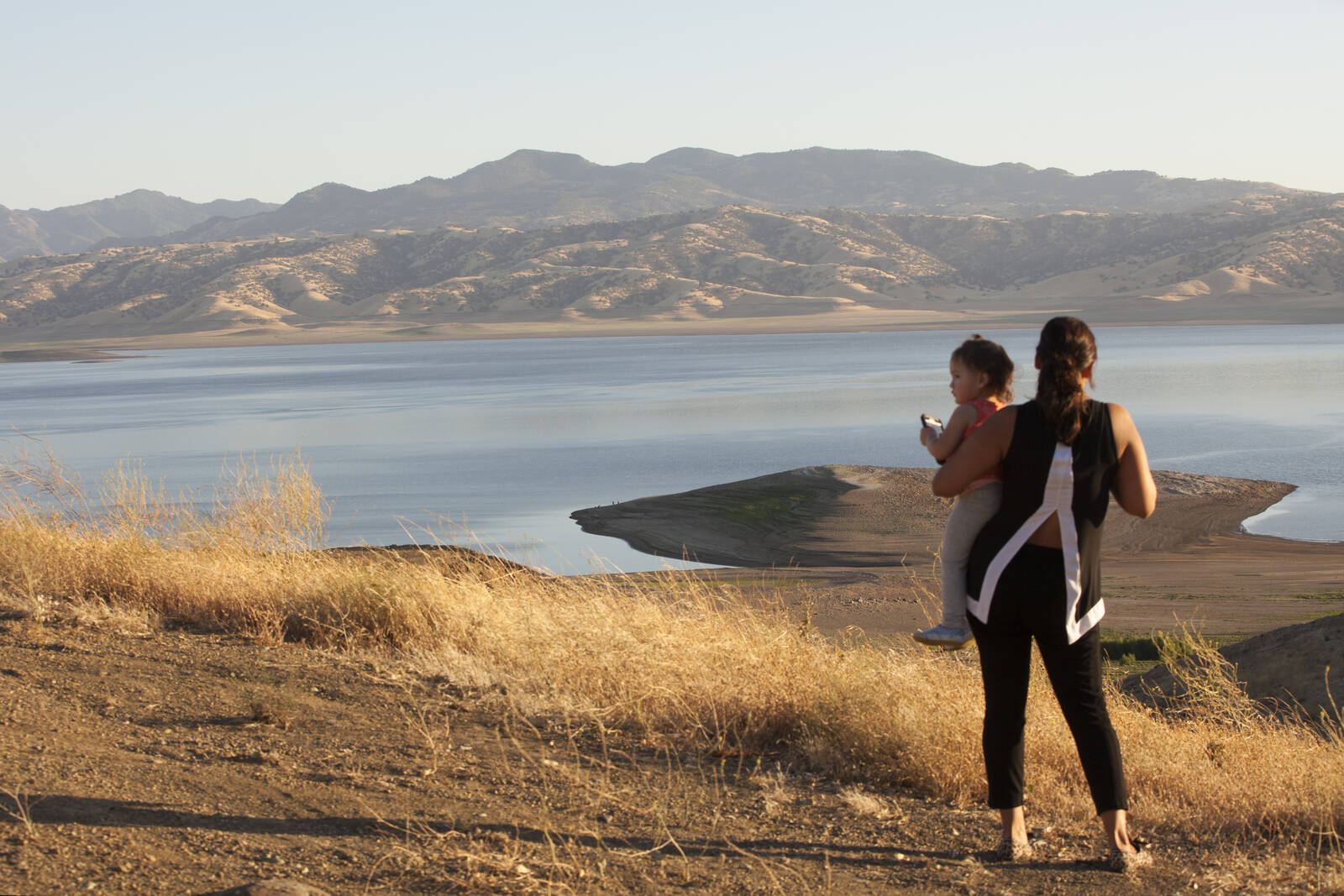 The San Luis Reservoir receives water from the San Joaquin-Sacramento River Delta. The water is pumped uphill into the reservoir and released to continue downstream along the California Aqueduct for farm irrigation and other uses. Credit: Melanie Stetson