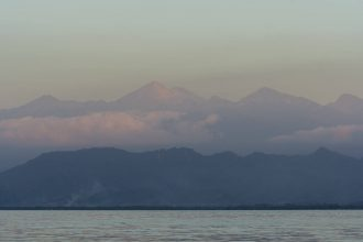 A view of Lombok Island, Indonesia, with Mount Rinjani or Gunung Rinjani which is an active volcano.