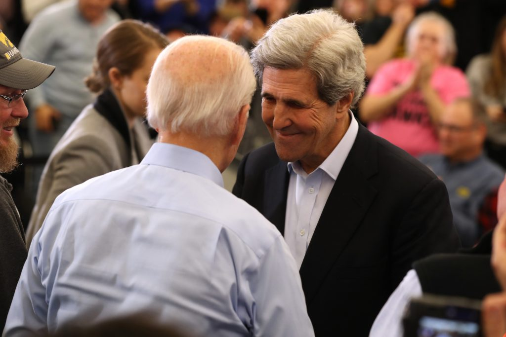 Former Secretary of State John Kerry greets Democratic presidential candidate former Vice President Joe Biden during a campaign event on February 01, 2020 in North Liberty, Iowa.