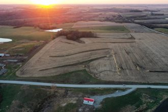 An aerial view of mostly harvested farmland at sunset on Oct. 30, 2020 in Lacona, Iowa. Credit: Mario Tama/Getty Images