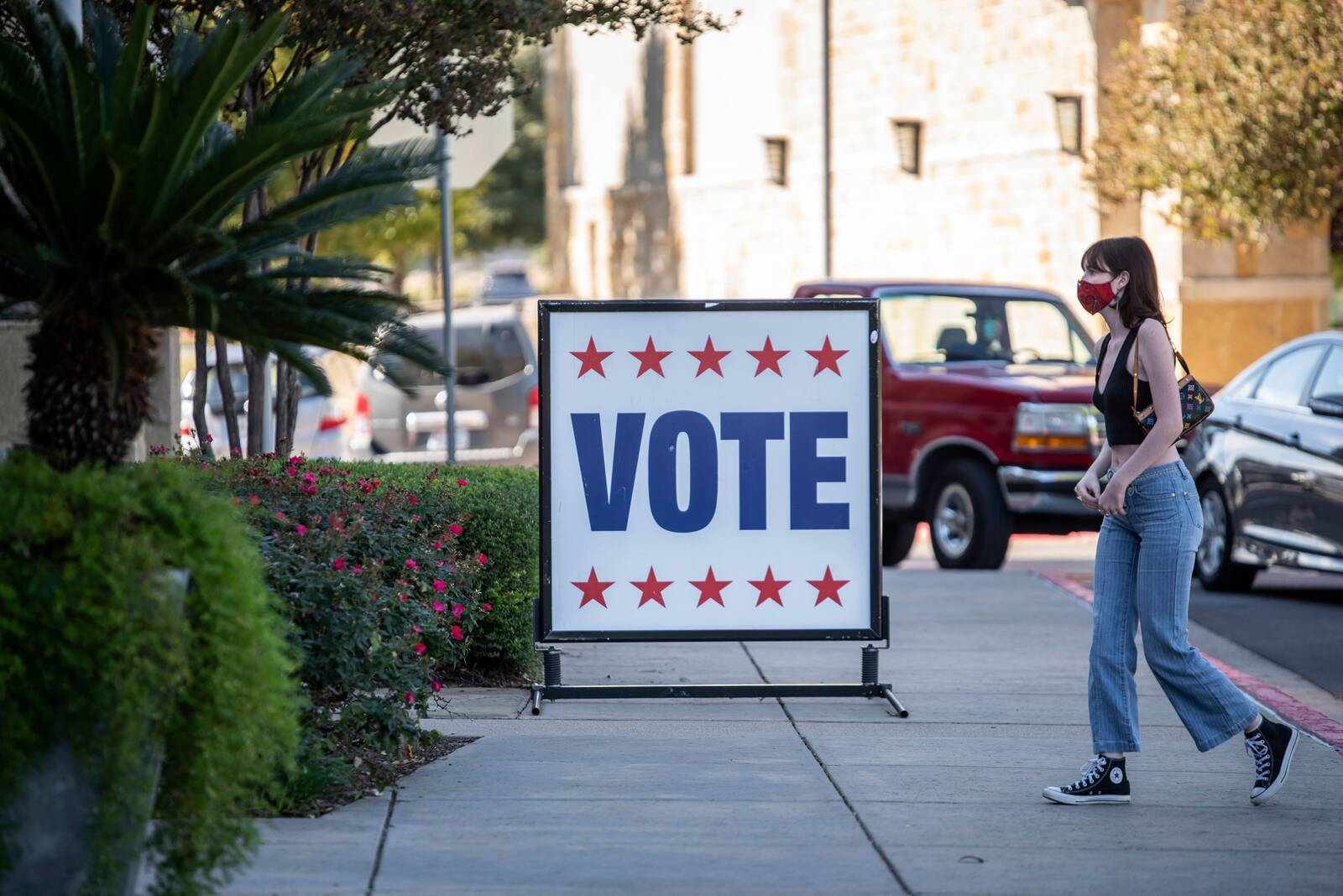 A voter walks toward a polling location on election day in Austin, Texas on Nov. 3, 2020. Credit: Sergio Flores/AFP via Getty Images
