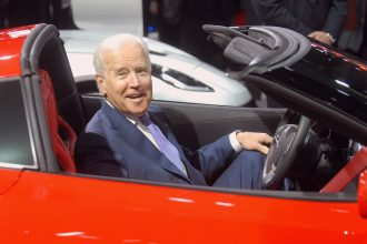 U.S. Vice-President Joe Biden sits in a Corvette at the North American International Auto Show industry preview on January 16, 2014, in Detroit, Michigan.