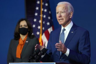 President-elect Joe Biden speaks to the media while flanked by Vice President-elect Kamala Harris, at the Queen Theater after receiving a briefing from the transition Covid-19 advisory board on Nov. 9, 2020 in Wilmington, Delaware. Credit: Joe Raedle/Gett