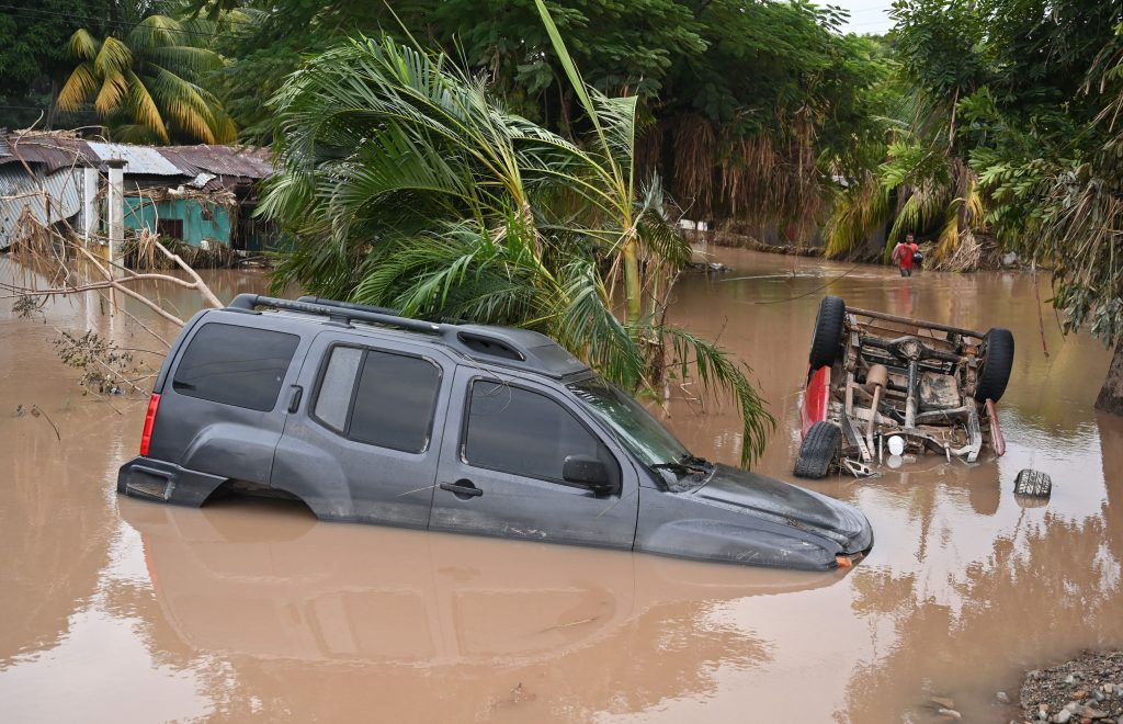 Cars remain partially submerged in Guadalupe Umanzor, municipality of La Lima, in the Honduran department of Cortes, after the passage of Hurricane Eta, later downgraded to Tropical Storm, on Nov. 10, 2020. Credit: Orlando Sierra/AFP Getty Images